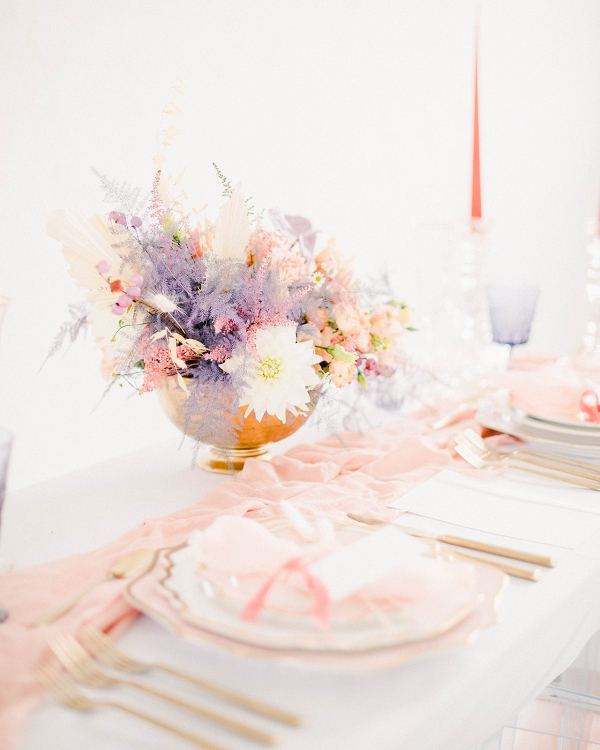 Pretty pink white and lilac wedding table decor