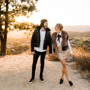 couple in the LA Hills wearing matching outfits for their engagement session