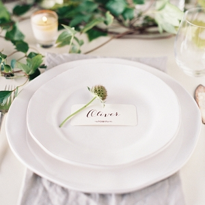 place setting with florals and foliage as a table runner