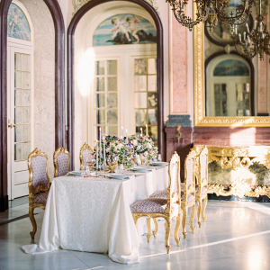 inside the palace of estoi and an elegant wedding tablescape design with gold chairs