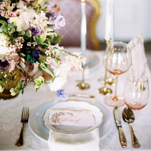 wedding table decor with gold cutlery pink glassware and elegant plates at palace of estoi
