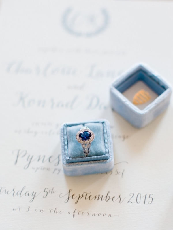 Vintage blue sapphire engagement ring in a blue velvet ring box with calligraphy stationery