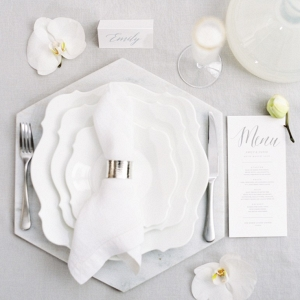 place setting display with orchid flowers and stationery