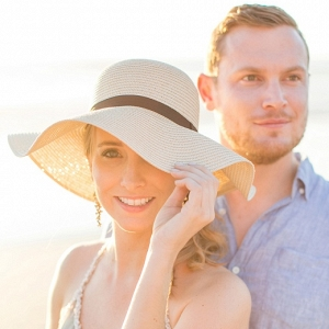 Romantic Beach Couple Shoot at Sunset with a Sun Hat