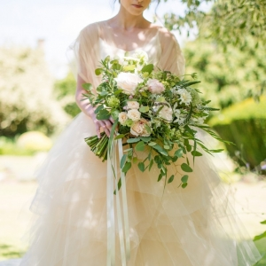 Wild organic summer wedding bouquet with garden roses and trailing ribbons