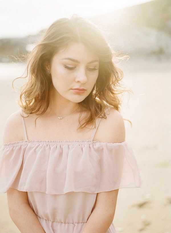 beautiful light luminous engagement session beach portrait