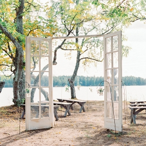 lakeside ceremony outdoors with statement door frame