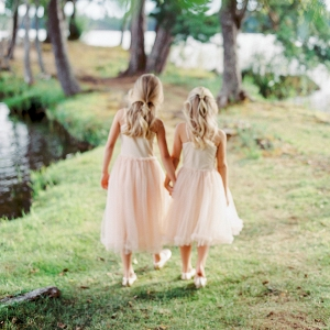 flower girls wearing pink holding hands