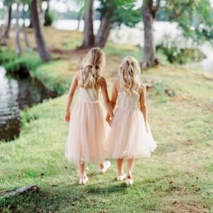 flower girls wearing pink holding hands