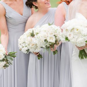 Lovely pale blue bridesmaids dresses with white bouquets!
