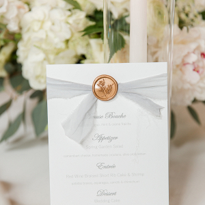 Elegant Menu design with pale blue ribbon and gold wax seal