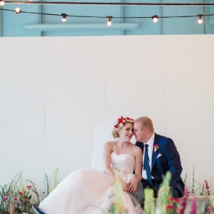 Art gallery and city park wedding with festoon lighting and an indoor flower meadow