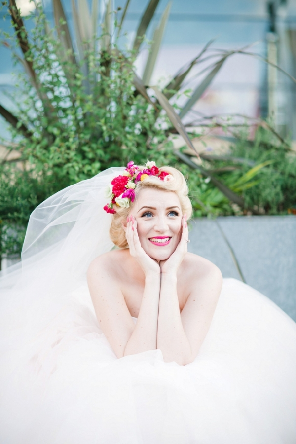 Carrie Bradshaw inspired bride wearing a pink & yellow floral crown and tulle veil