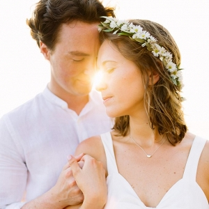 couple holding hands and the sunlight streams through