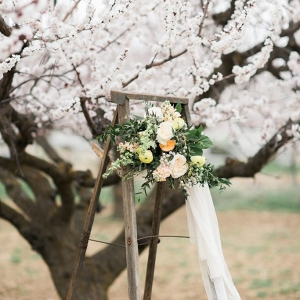 Beautiful wedding bouquet displayed on vintage wooden ladders