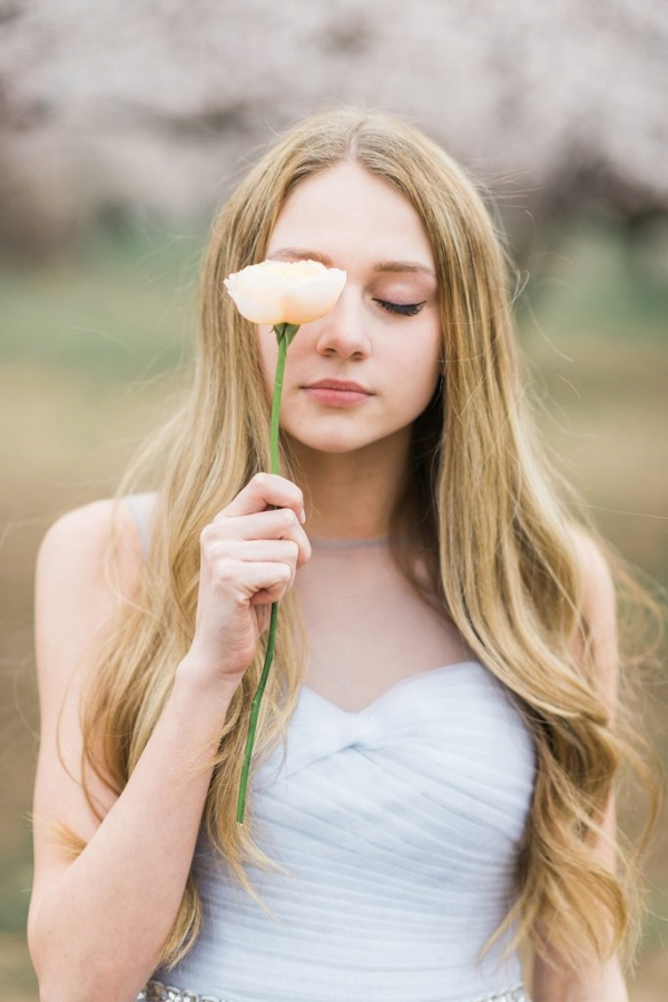 Wonderfully artistic bridal portrait using a single flower