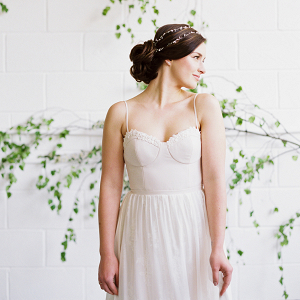 Modern bridal look for the Art of Styling workshop with foliage installation backdrop