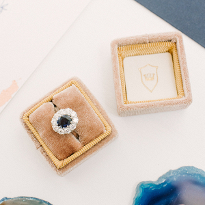 Elegant velvet ring box with saphire engagement ring