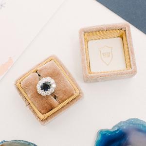 Elegant velvet ring box with saphire engagement ring