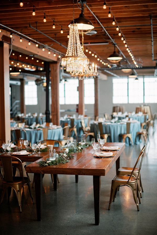 Modern industrial chic wedding reception tablescape inspiration with greenery and copper chairs