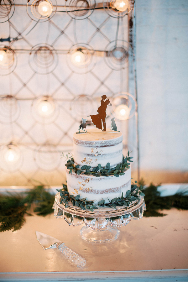 Semi-naked two tier wedding cake with copper cake topper