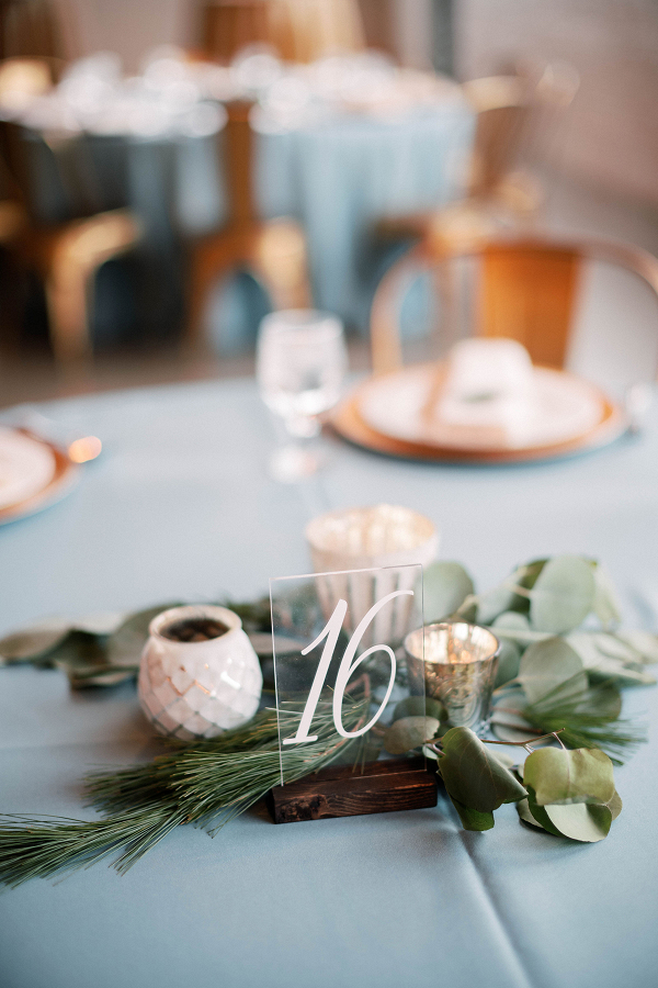 Hand lettering acrylic table number with greenery