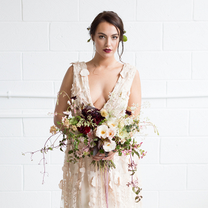 The beautiful wedding dress by Halfpenny London filled with embroidered flowers