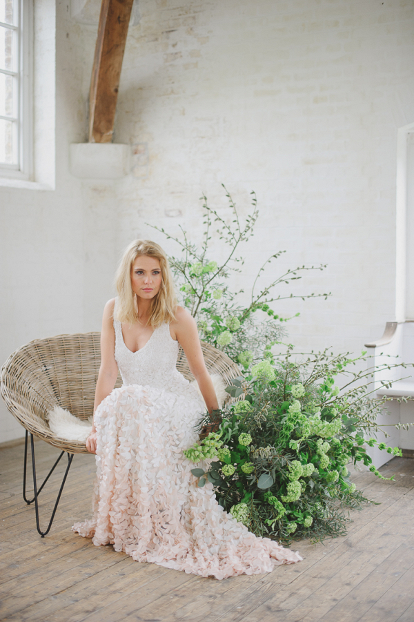 The Theia Emma wedding dress in ombre white to pink covered in silk petals