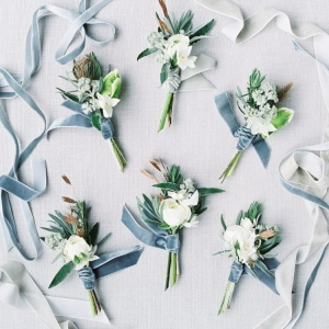 blue and grey winter wedding boutonnieres with dusky blue velvet ribbons