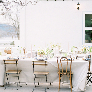 Rustic chic table setting in white with flourishes of green