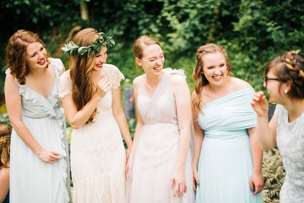 Bridesmaids in mismatch pastel gowns on Bridal Musings