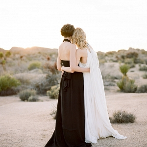 Beautiful couple in black and white dresses on Aisle Society