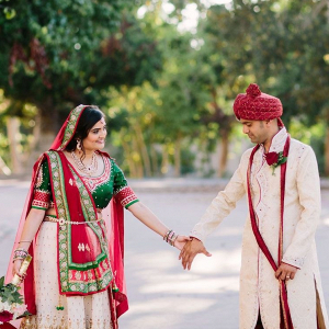 Couple in colorful Indian wedding attire on Bridal Musings