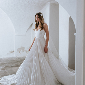 Pleated white wedding gown on Bridal Musings
