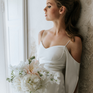Bride with white bouquet on Bridal Musings