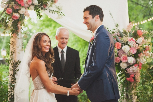 Ceremony with draping and floral backdrop on Bridal Musings