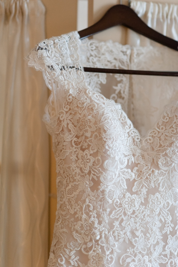 The Bride at this Chic Navy Blue & Gold Museum Wedding Dazzled in an Ivory Lace Eddy K Wedding Dress with Cap Sleeves