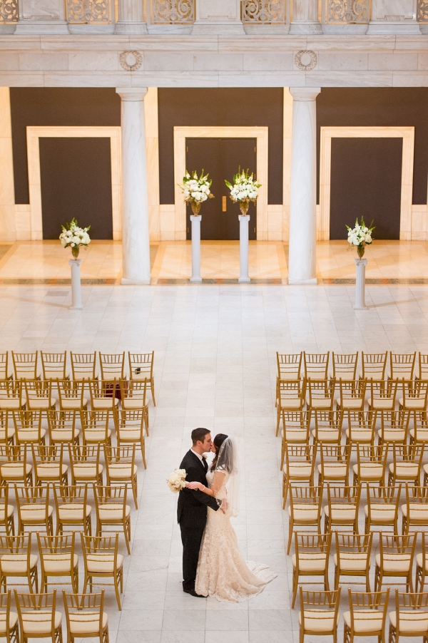 Chiavari Chairs Flank an Epic Wedding Ceremony Site at this Navy Blue & Gold Museum Wedding
