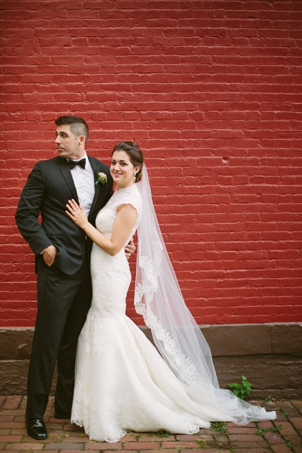 Gorgeous Bride Groom Stealing Moment Wedded Bliss Red Brick Wall