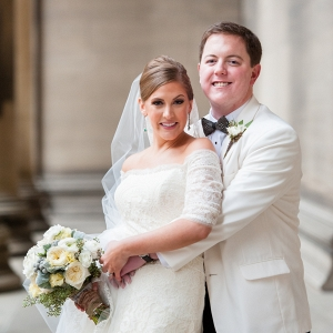 Emerald and Diamond Drop Earrings, a Lace Wedding Dress, a White Tuxedo Jacket, and a Feather Bow Tie Look Amazing on This Bride and Groom Before Their Classic Emerald Winter Pittsburgh Wedding
