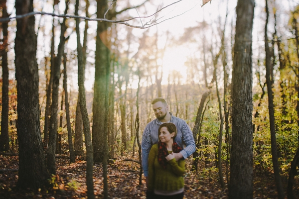 A Barren Woodland, Crunchy Leaves, and a Glowing Sunset Make for a Beautiful Natural Background During This Crisp, Cozy Engagement Session