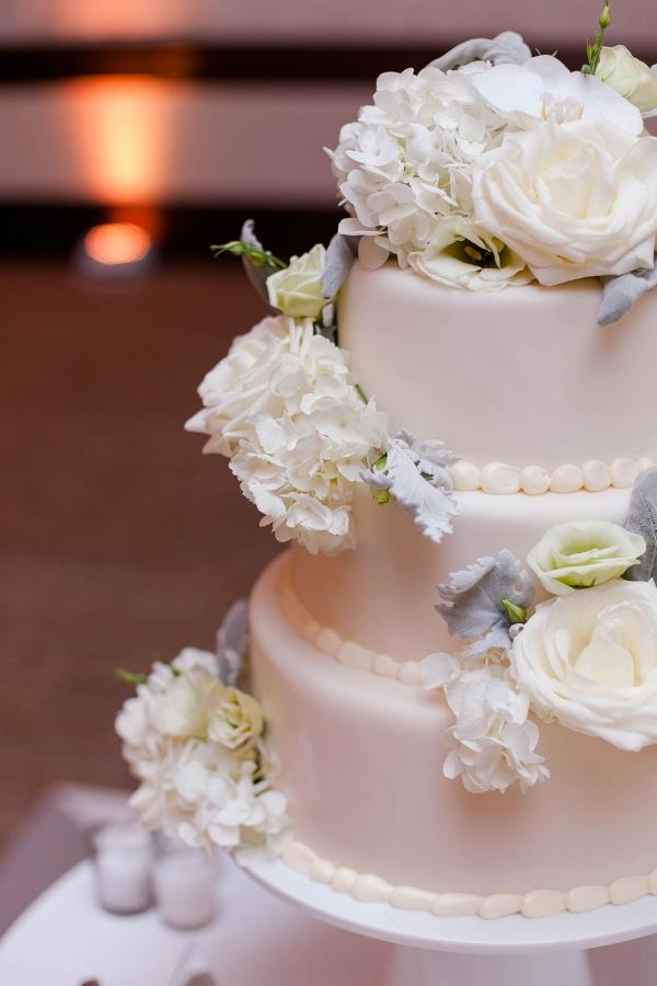 Fresh White Flowers Three Tiered Fondant Wedding Cake