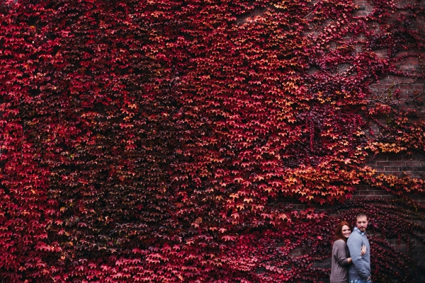 Red Yellow Leaves Brick Wall Fall Foliage Engagement Session