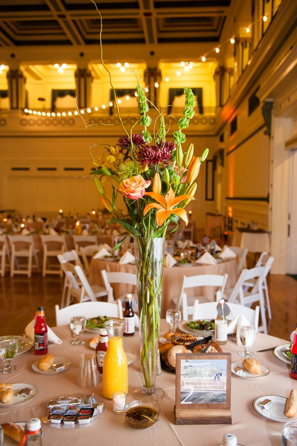 Fall Inspired Brunch Wedding Reception Tall Floral Centerpieces Bistro Lights DIY Table Numbers Donuts