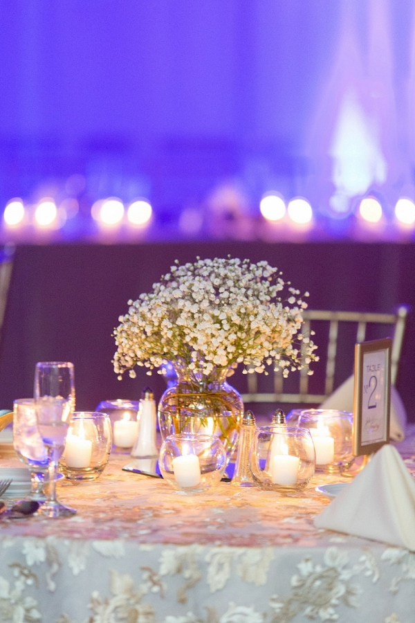 Romantic Uplighting, Tons of Candles, and Floral Centerpieces Set the Scene at This Glamorous Winter Wedding