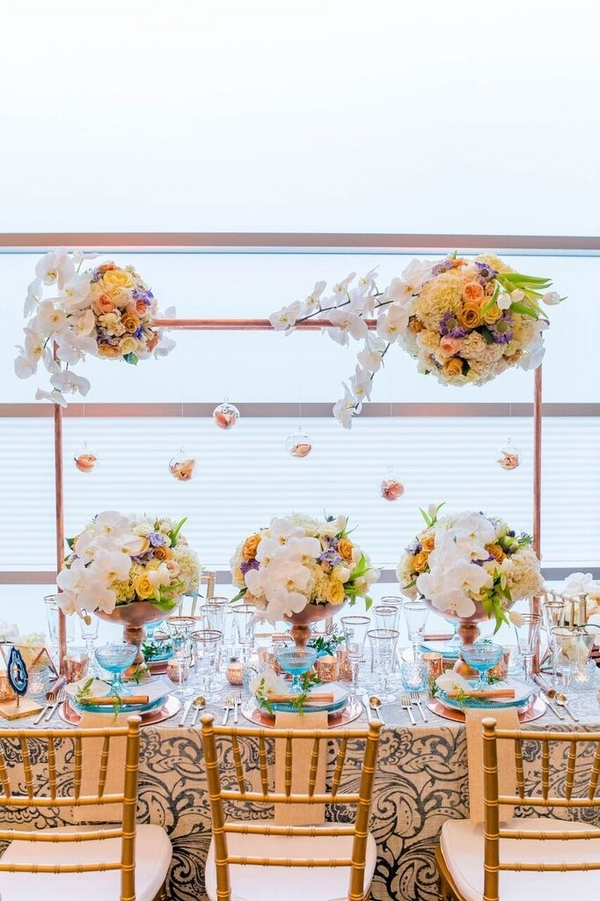 Lush Hanging Florals Patterned Linens Copper Accents Bright Glassware Highlights Modern Geometric Styled Shoot
