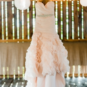 Ruffles, a Sweetheart Neckline, and a Beaded Belt Decorate this Blush Pink Wedding Dress