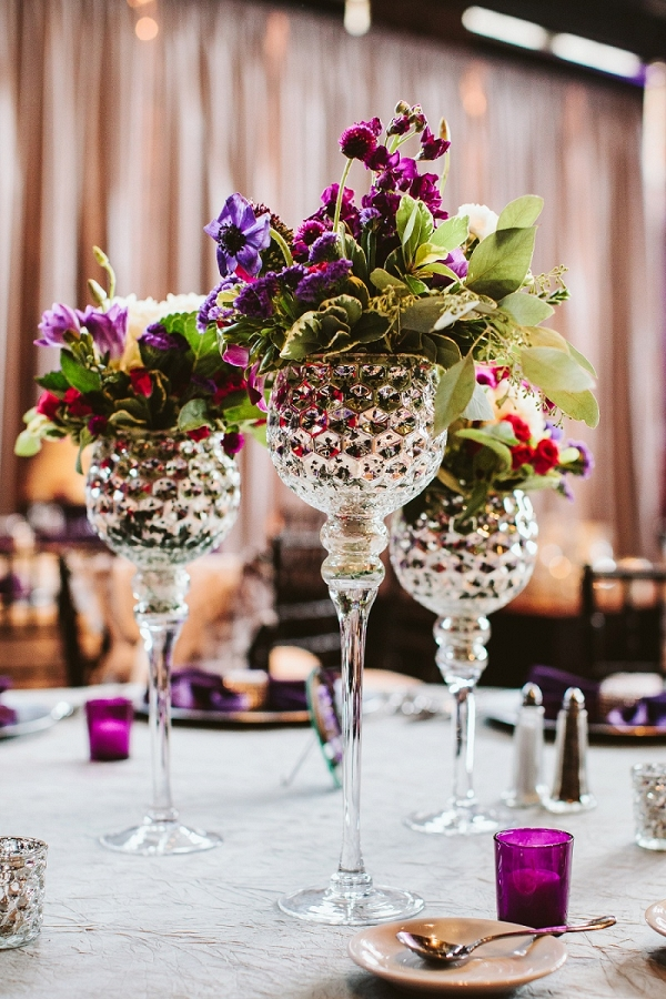 Mercury Glass Candle Holders Serve as Vases for Floral Centerpieces