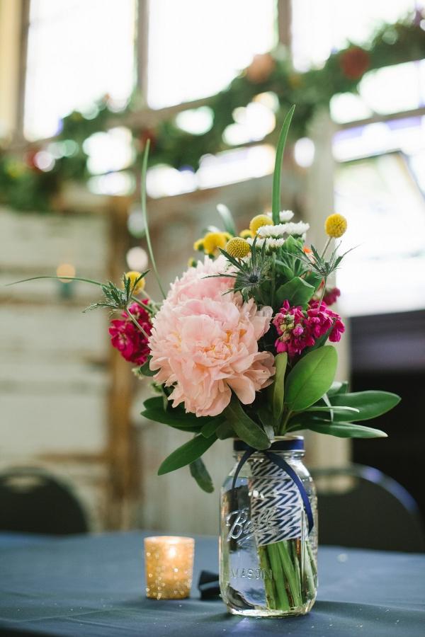 Wildflower-Inspired Mason Jar Centerpieces Floral Garland Vintage Rentals Unique Setting Whimsical DIY Wedding