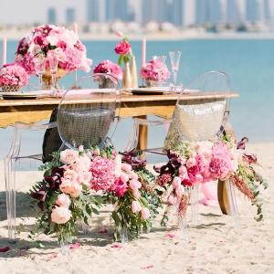 Luxurious hot pink and gold Dubai beach wedding